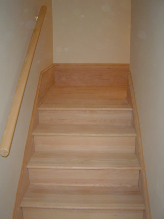 Hardwood staircase trim out